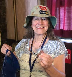 Cathy with End Polio pins on her hat